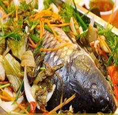 Bí quyết nấu canh cá dưa chua thơm ngon cho bữa cơm trưa nắng
