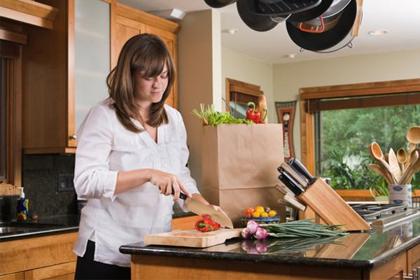 woman-with-wooden-cooking-board